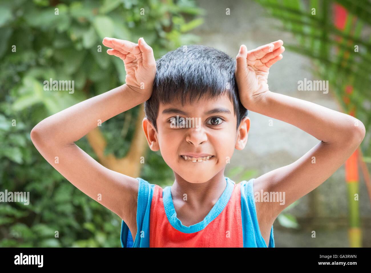 Kid showing emotion of anger, surprise, rage, distress - Stock Image