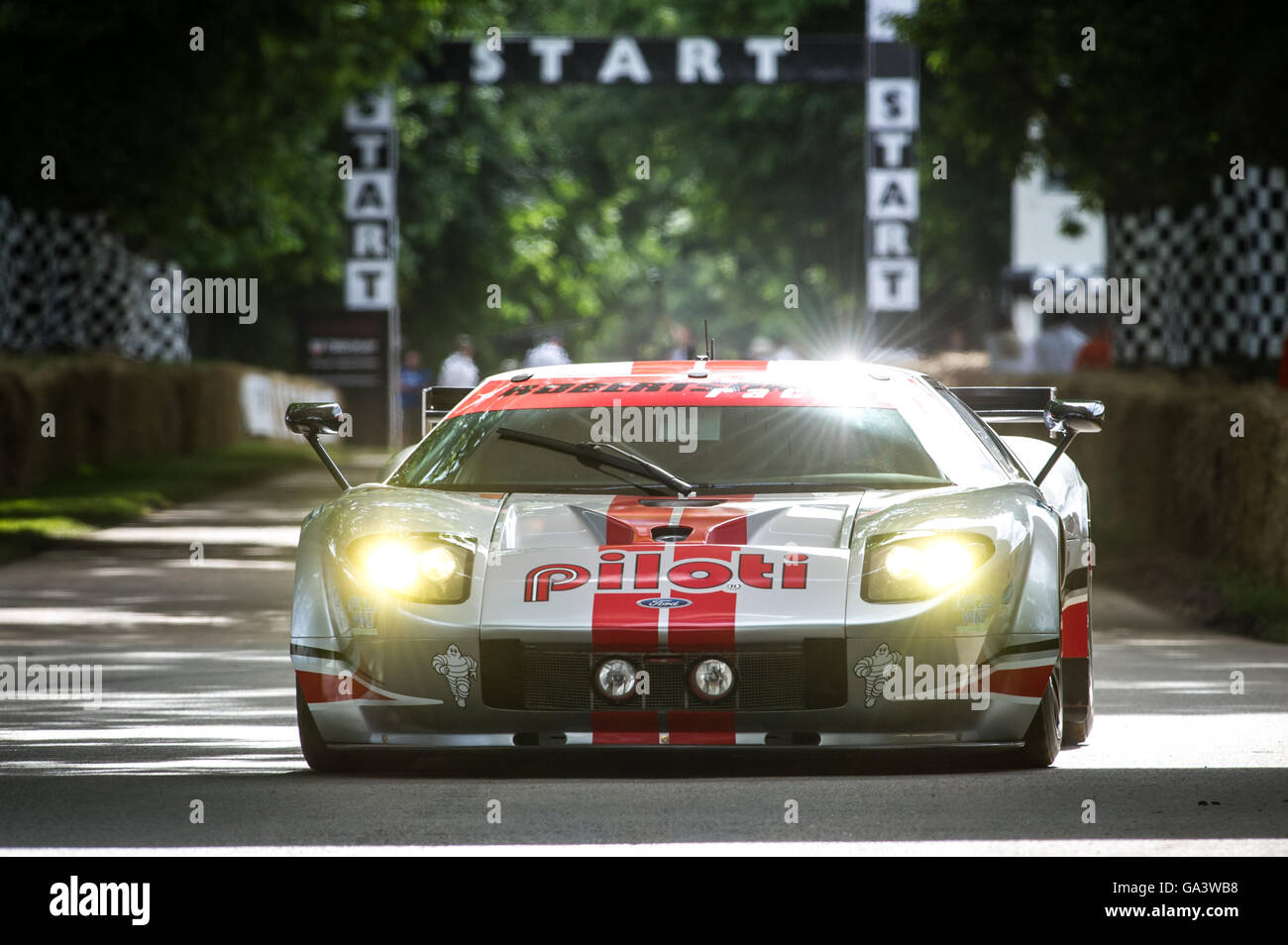 A Ford Gt Lm Gte Drives Up The Hill At The Goodwood Festival Of Speed