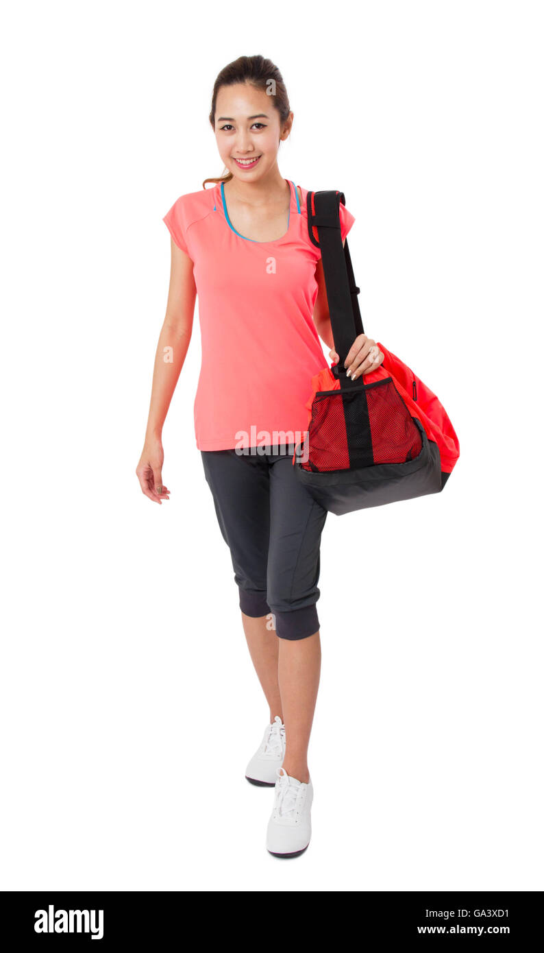8f7d9d76 Asian Smiling fit young woman with gym bag standing ready for fitness  exercise Isolated on white