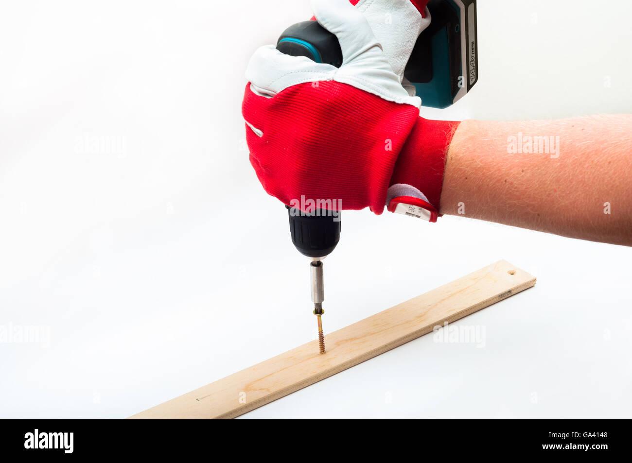 Screwing witn electrical screwdriver - Stock Image