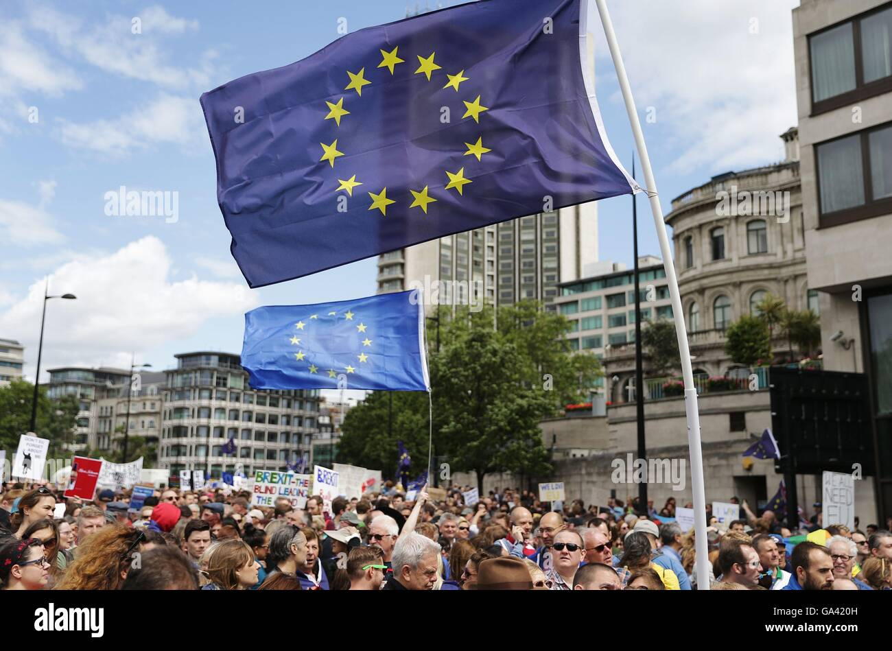 European Union flags fly above Remain supporters near Park Lane in London, as they march to Parliament Square to - Stock Image