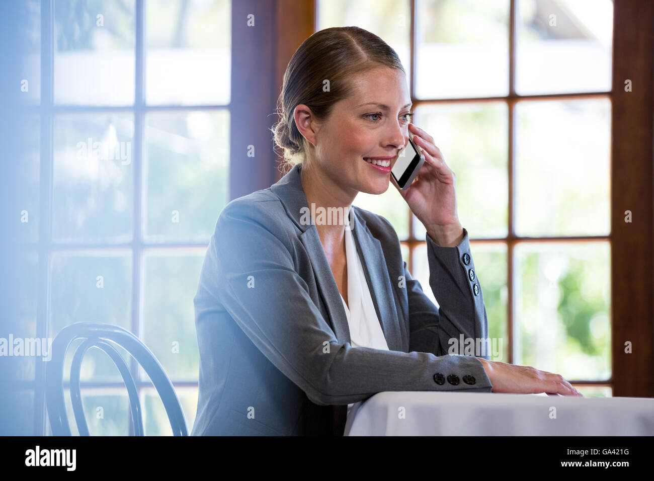 Woman making a phone call - Stock Image