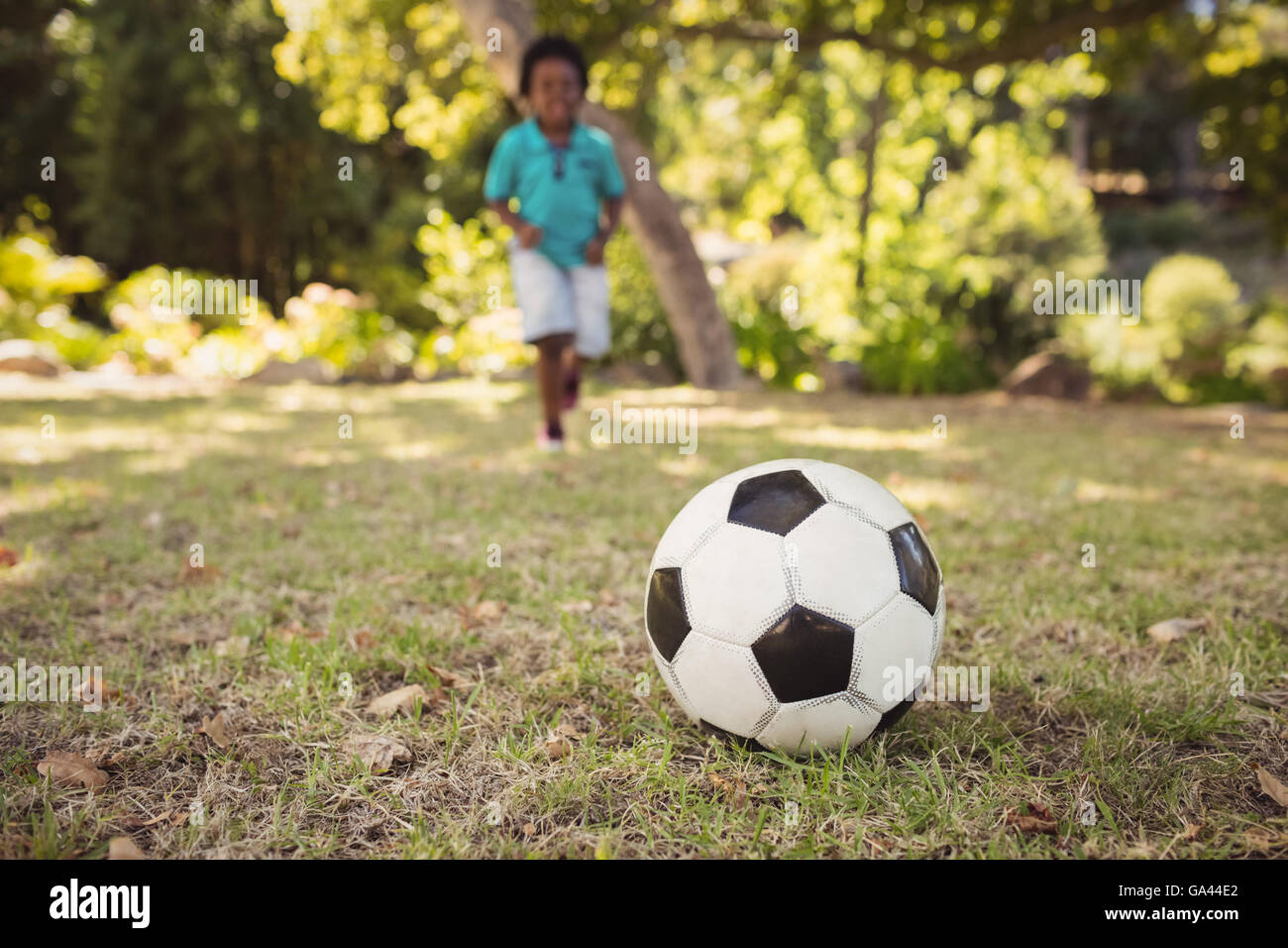 happy child playing football Stock Photo