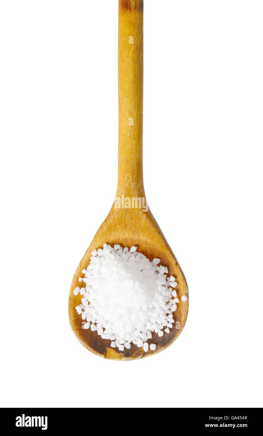 Coarse grained salt on wooden spoon - Stock Image