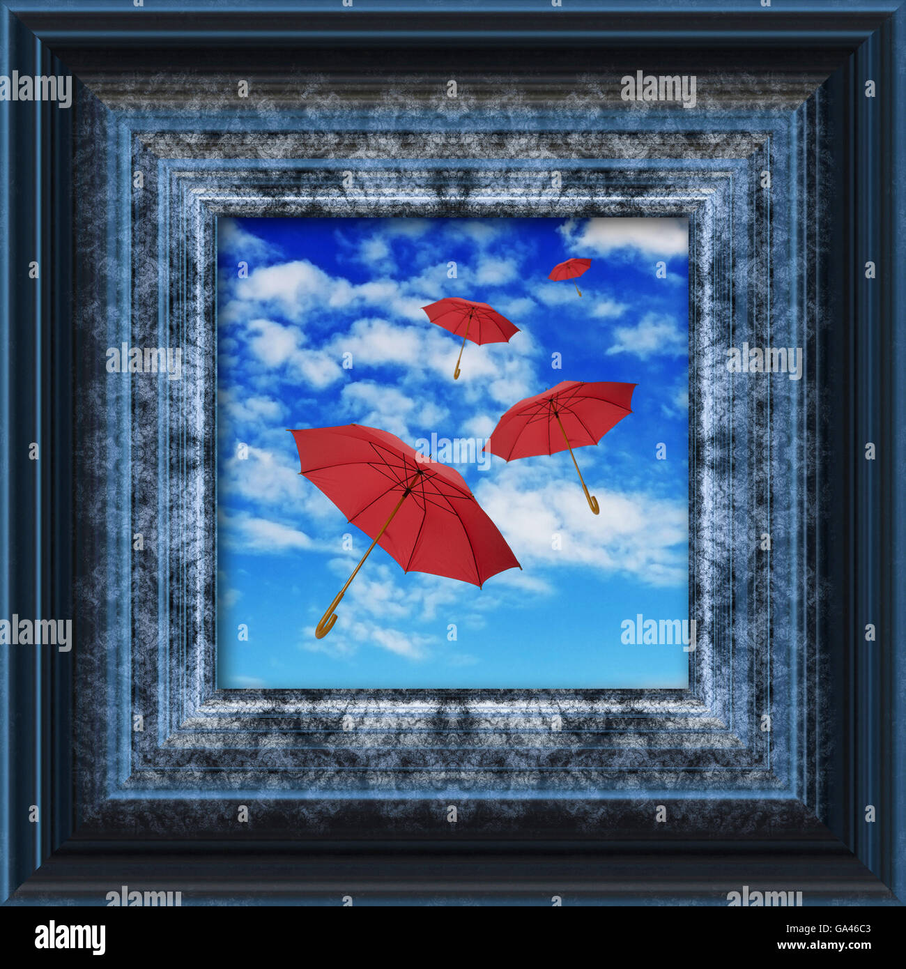 red umbrellas flying in the sky, inside a picture frame - Stock Image