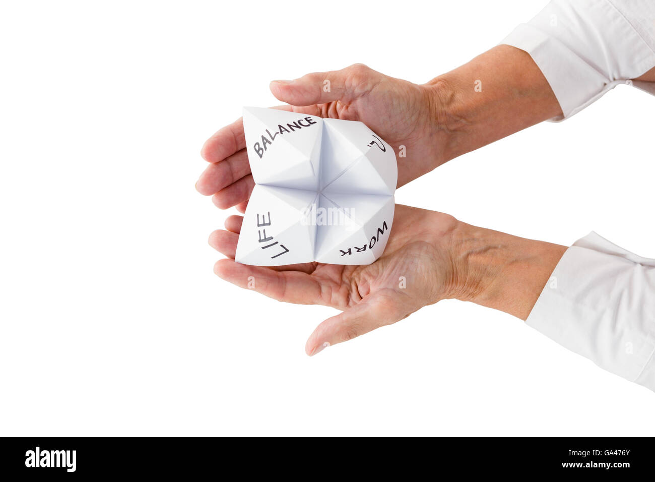Person holding origami fortune teller - Stock Image