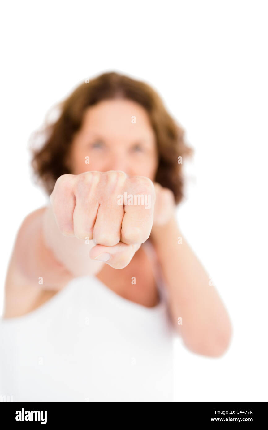 Portrait of woman punching - Stock Image