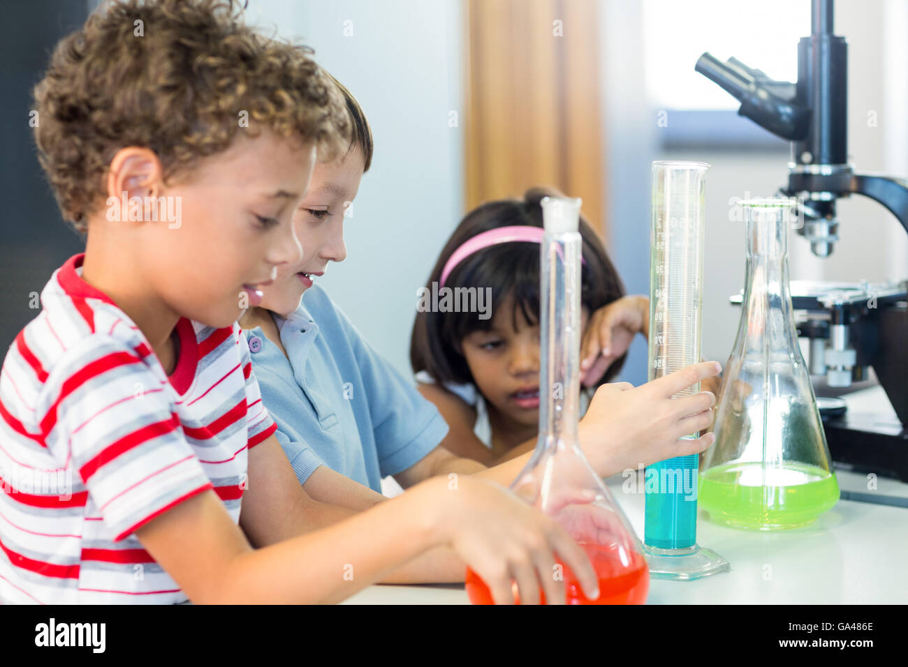 Schoolchildren with scientific equipment - Stock Image