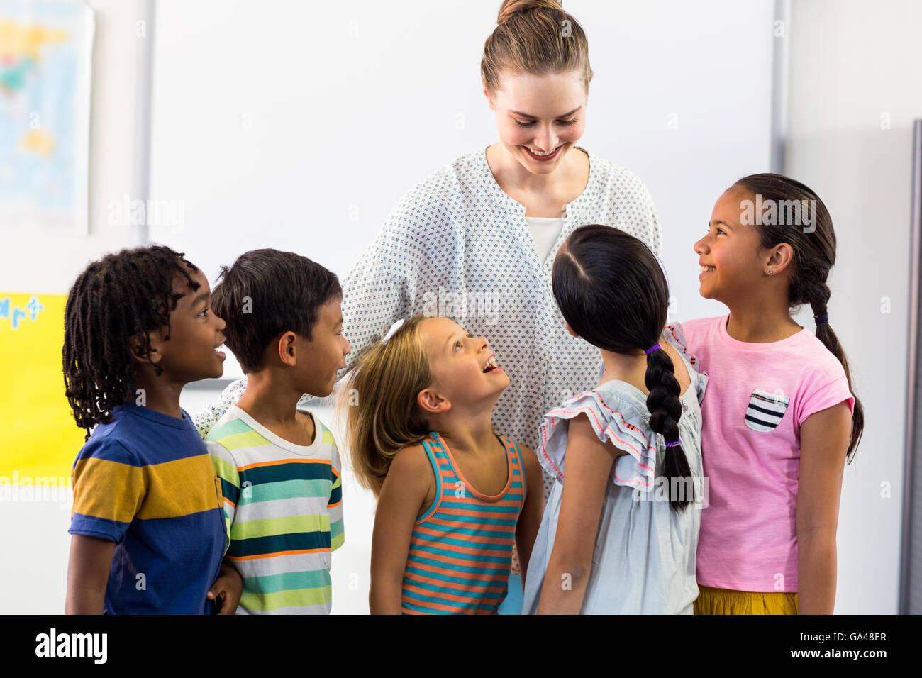 female teacher with schoolchildren - Stock Image