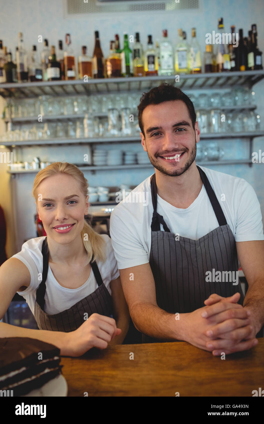Portrait of co-workers at cafe - Stock Image