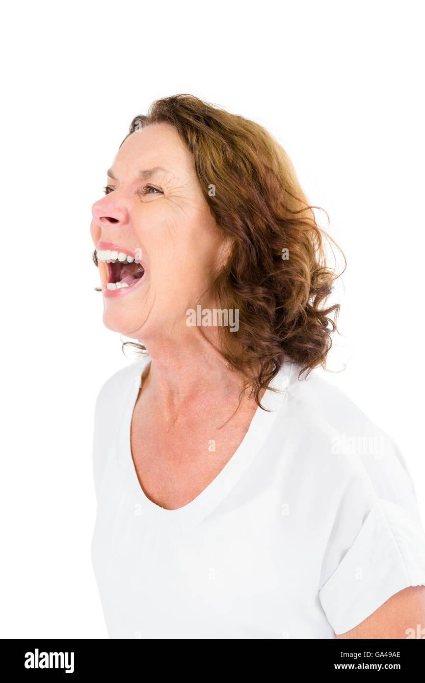Angry mature woman shouting - Stock Image