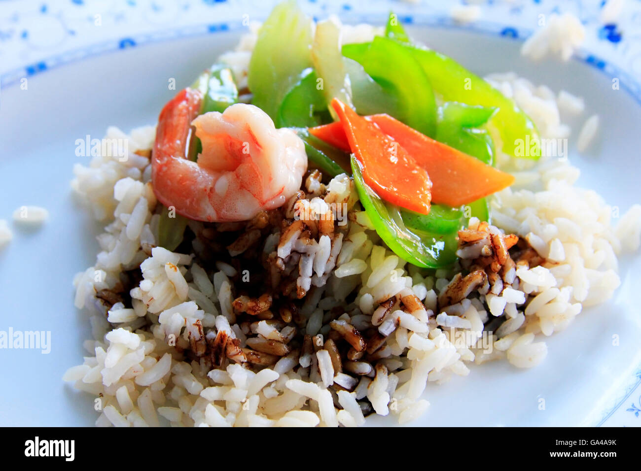 Cooked rice and prawns with souse - Stock Image