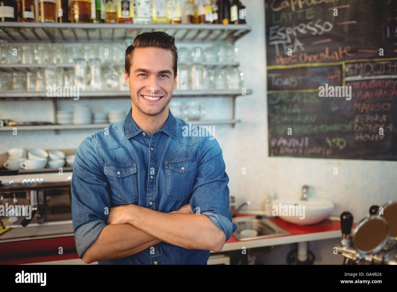 Portrait of handsome cafe owner - Stock Image