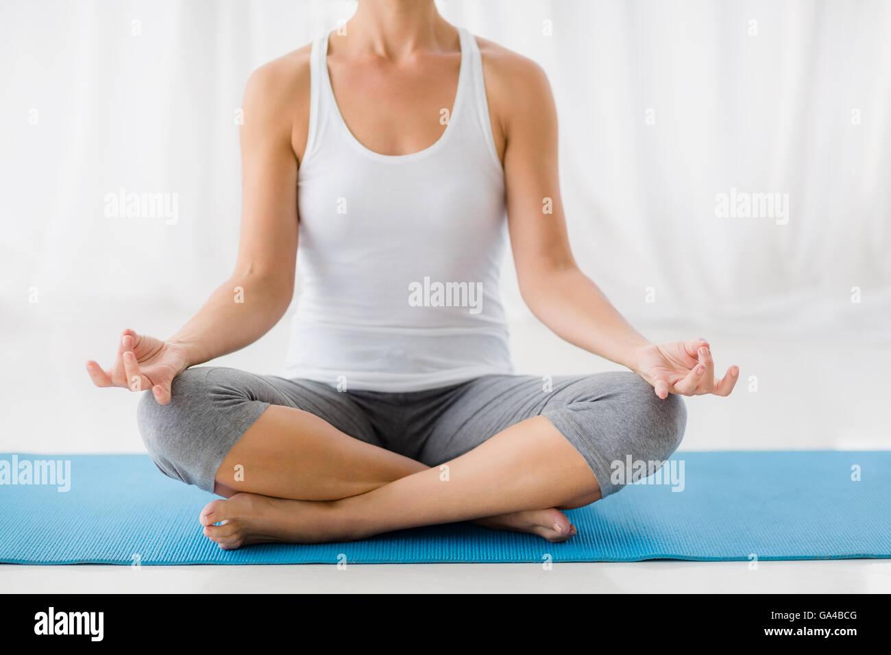 Woman performing yoga - Stock Image