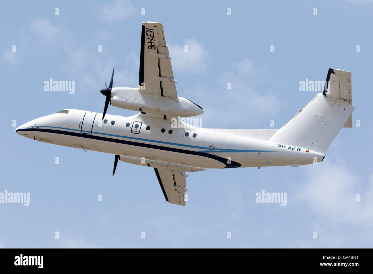 Medavia De Havilland Canada DHC-8 Dash 8 [9H-AEW] climbing out of runway 13. - Stock Image