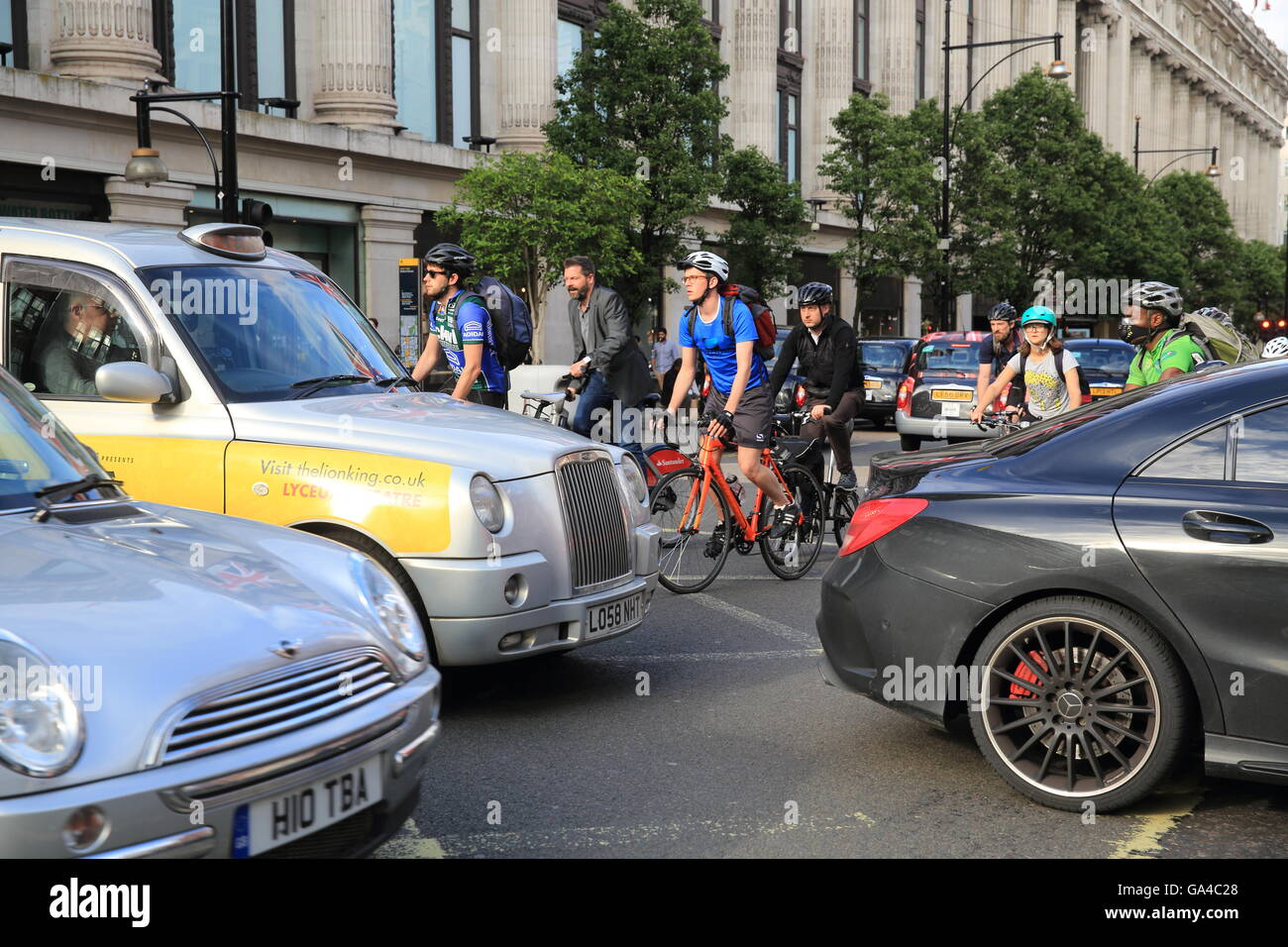 Traffic congestion at rush hour at a junction on Oxford Street, next to Selfridges, in London's West End, England, - Stock Image