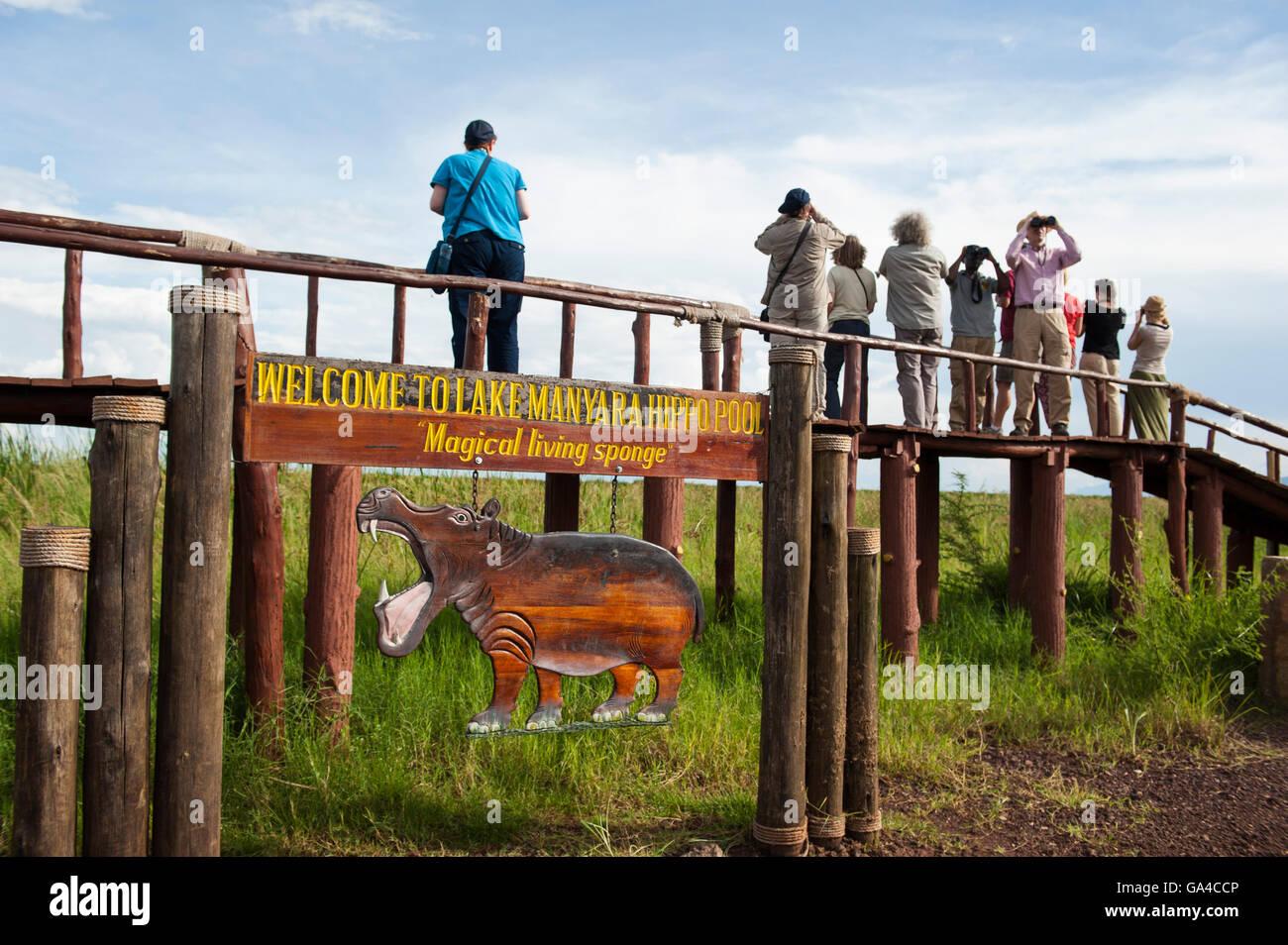 Tourists overlooking the hippo pool, Lake Manyara National Park, Tanzania - Stock Image