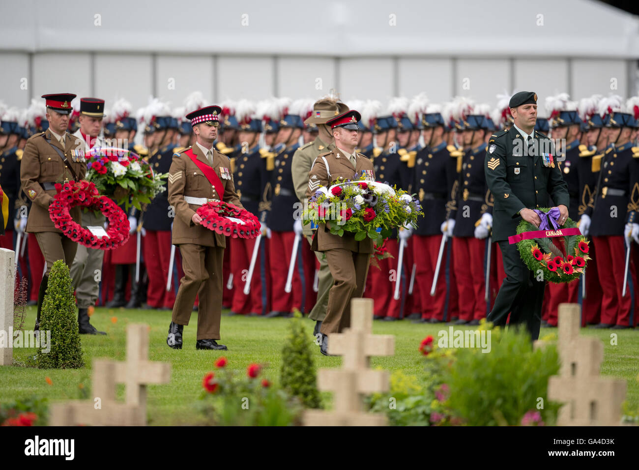 British, French, Australian, New Zealand and Canadian soldiers carry wreaths during the ceremony marking the 100th Stock Photo