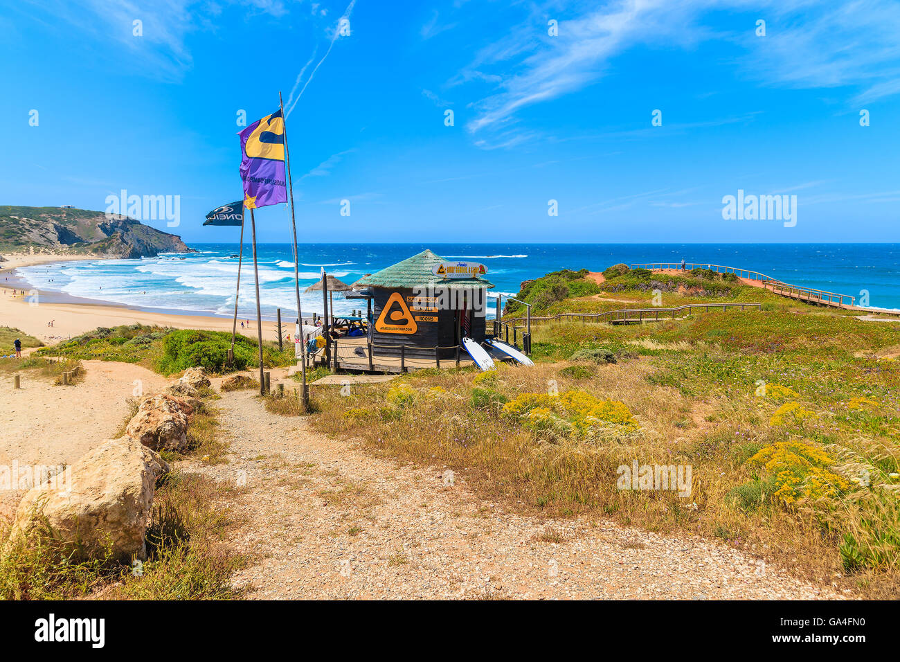 AMADO BEACH, PORTUGAL - MAY 15, 2015: surfing school kiosk on Praia do Amado beach in spring, Algarve region, Portugal. Stock Photo