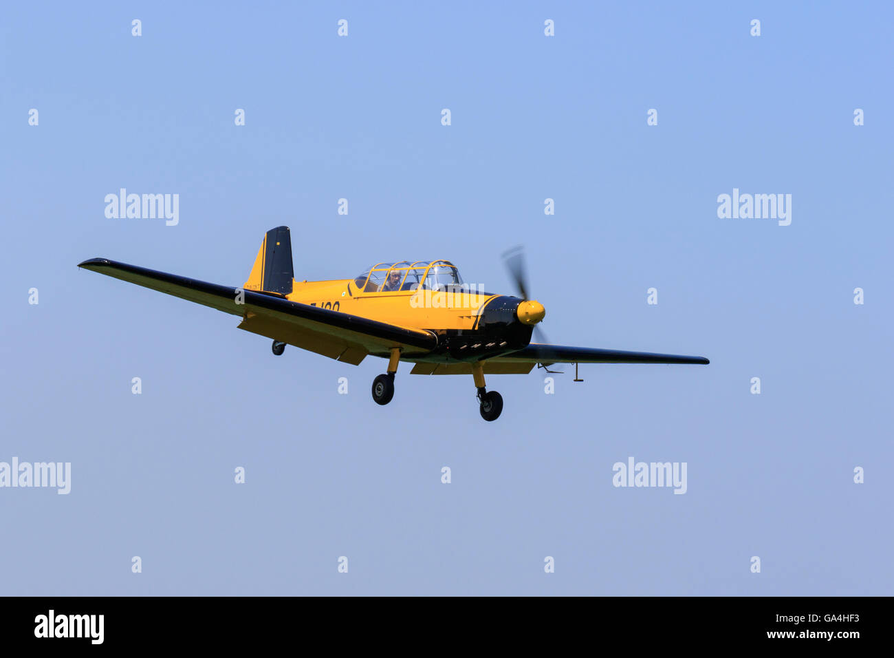 Zlin Z226T Trener G-EJGO on final approach to land at Sturgate Airfield - Stock Image