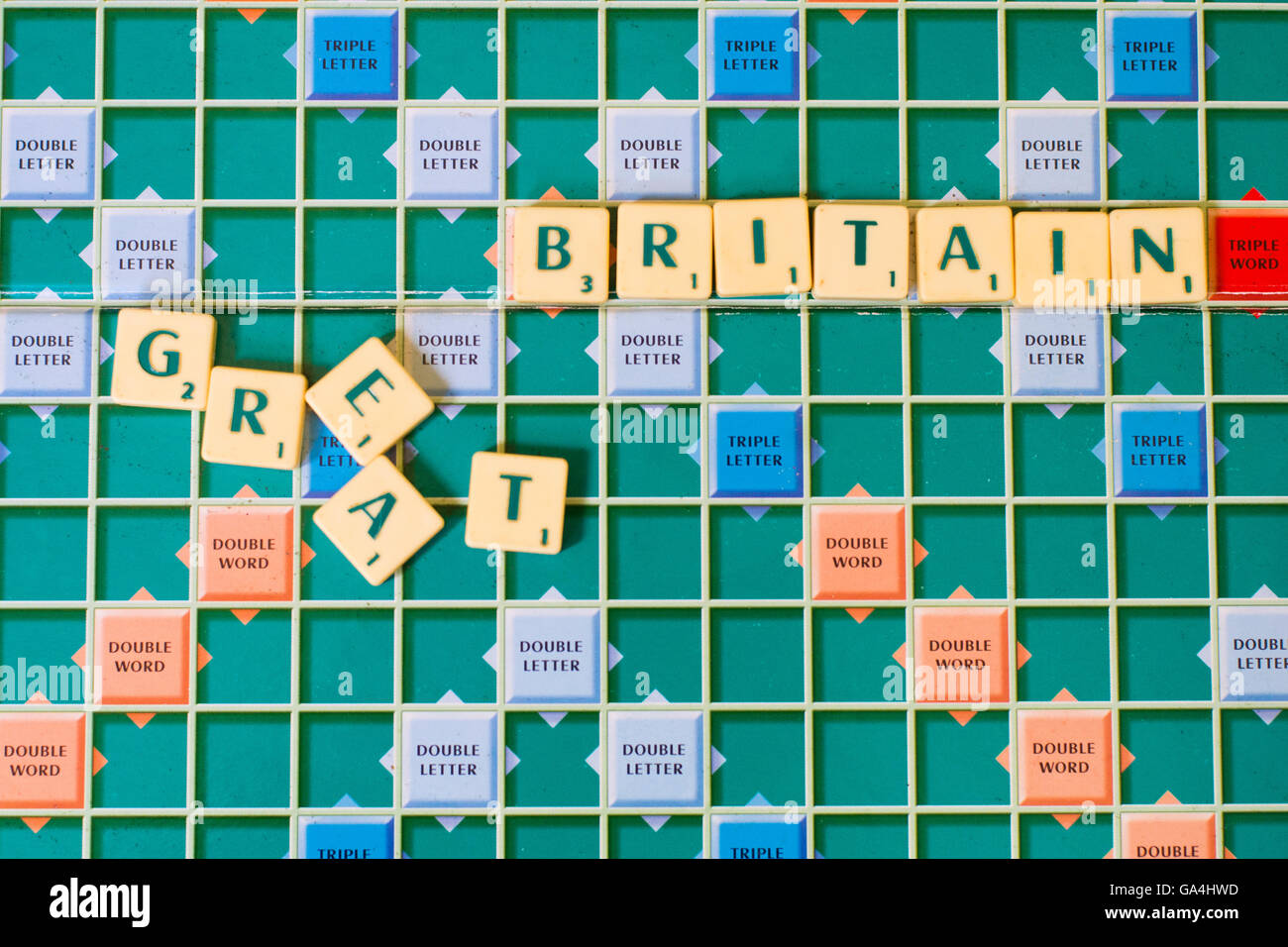 Scrabble tiles spelling out Great Britain with the Great scattered, symbolising the demise of Great Britain after - Stock Image