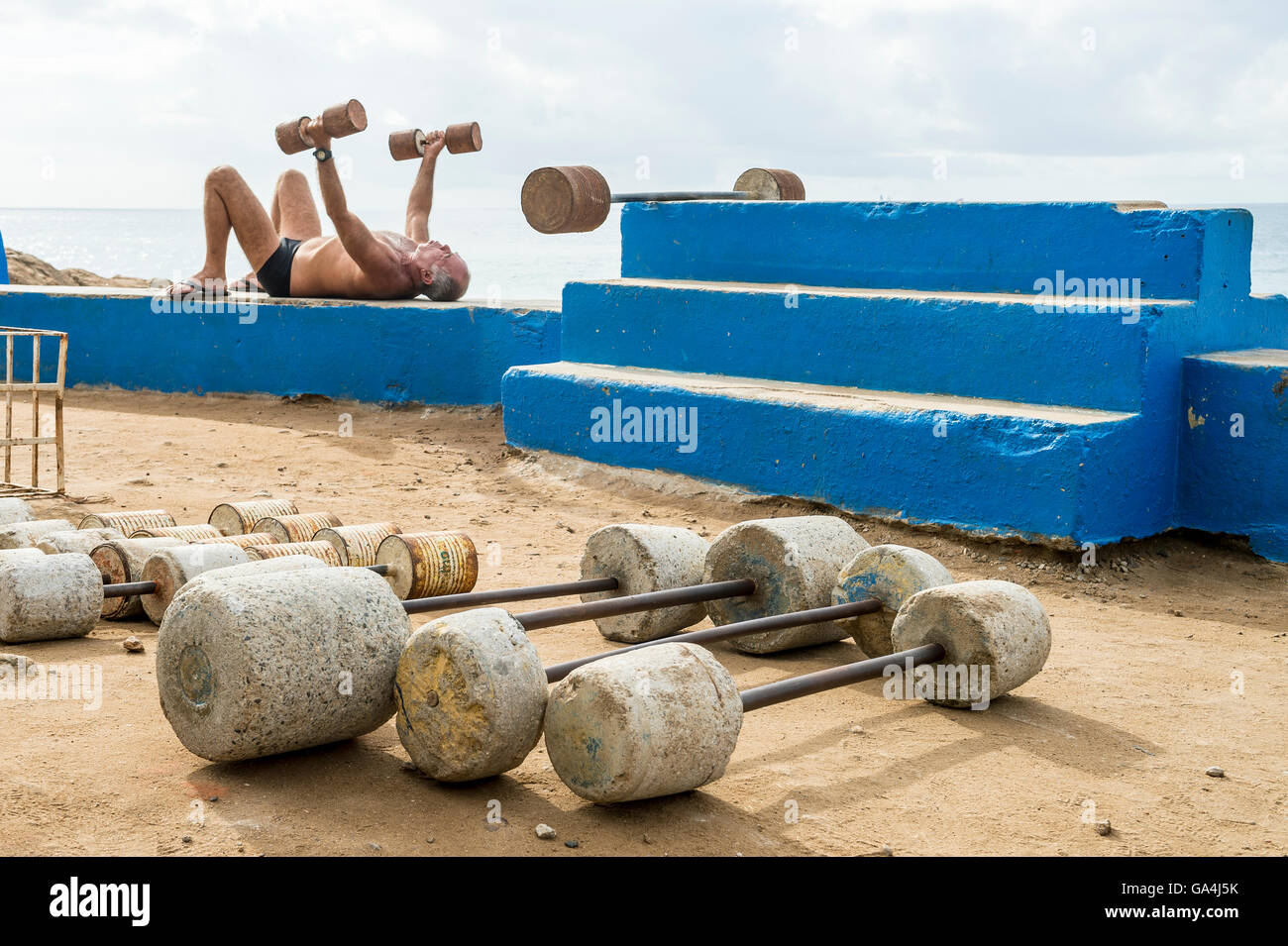 RIO DE JANEIRO - FEBRUARY 12, 2015: Brazilian man exercises at the outdoor workout station at the rocky point of - Stock Image