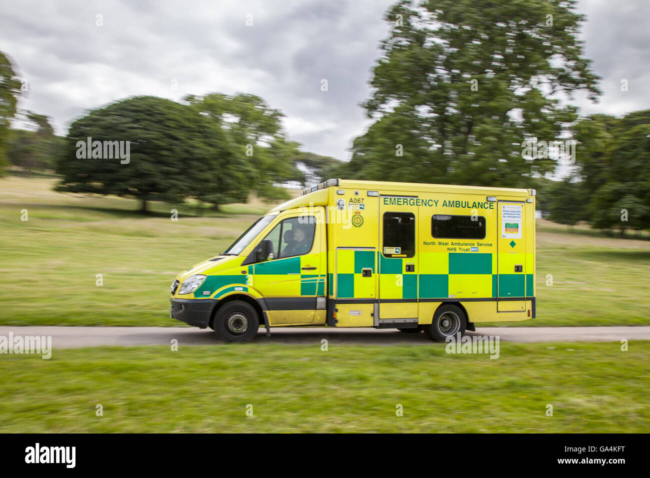 999 NHS Emergency North west ambulance service countryside vehicle en-route to incident in rural Leighton Hall, Stock Photo