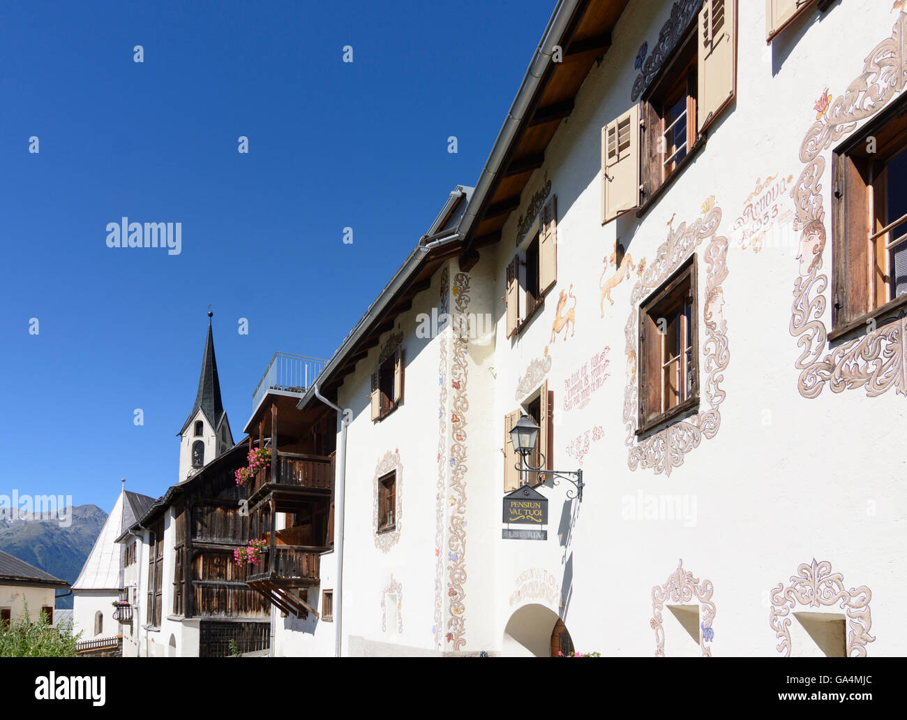 Guarda with sgraffito decorated houses, church Switzerland Graubünden, Grisons Unterengadin, Lower Engadine - Stock Image