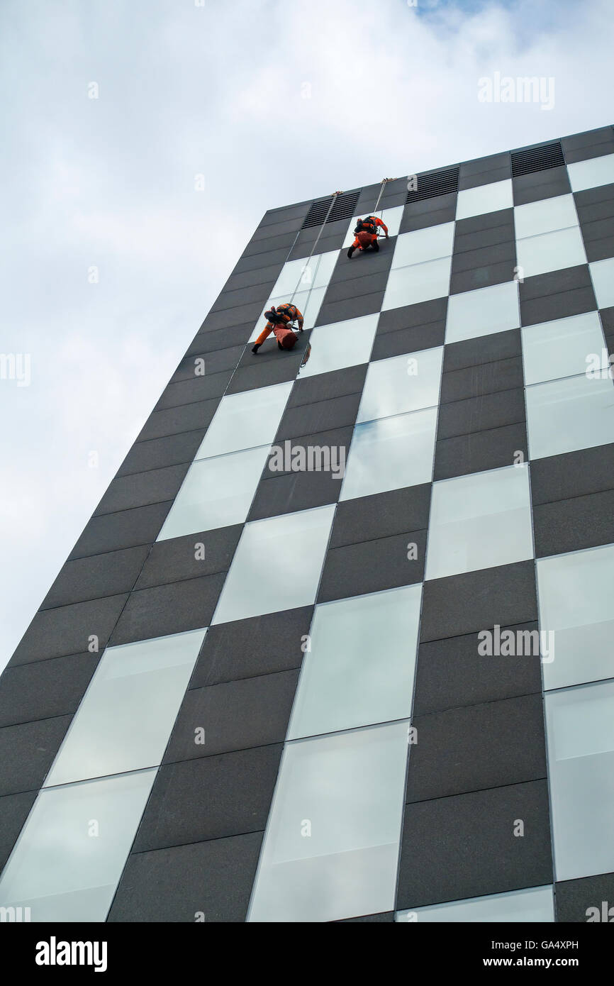 High Level Window Cleaning Window Cleaners on Ropes - Stock Image