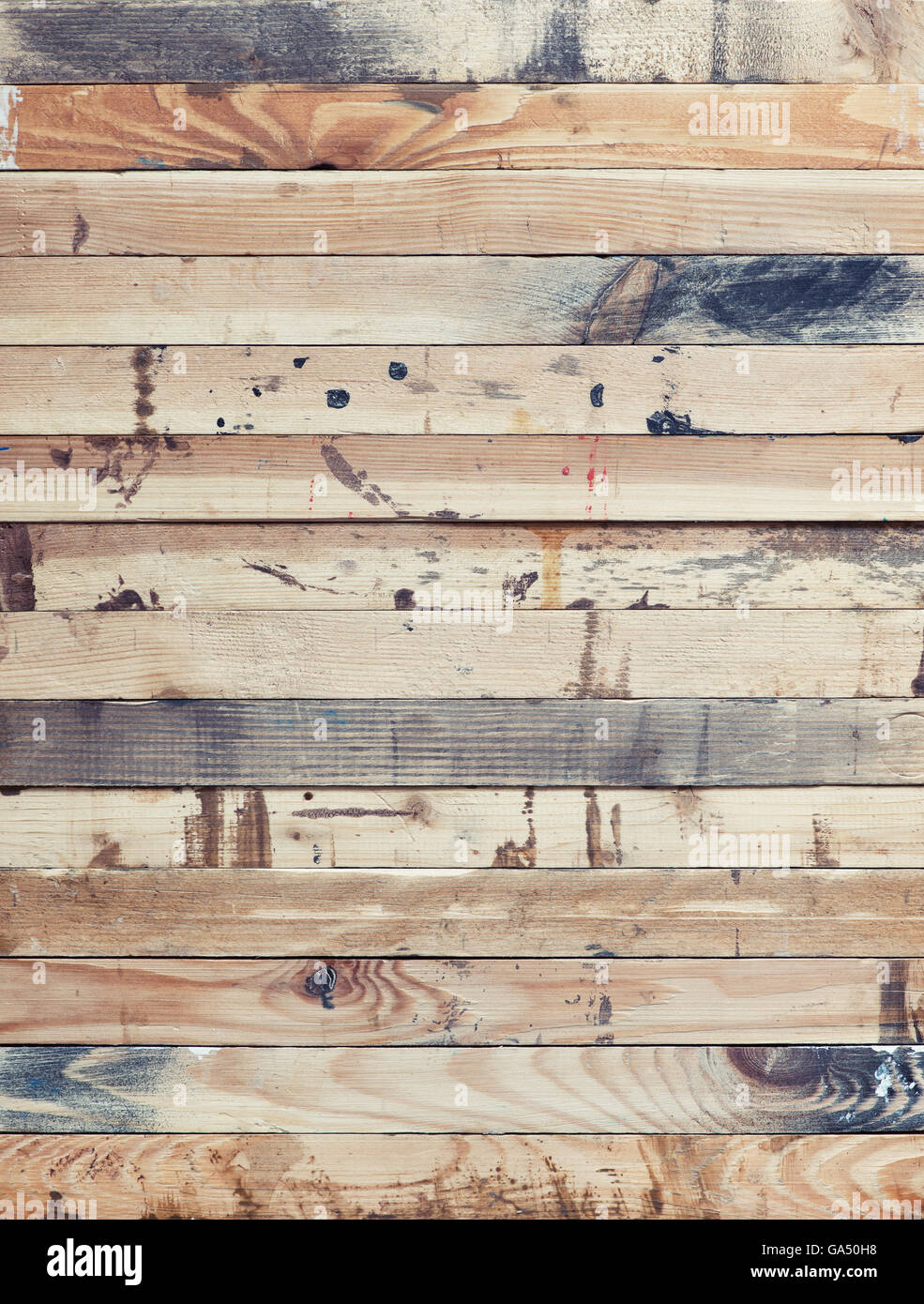 Stack of rough wood strips Grungy wood texture with paint stains
