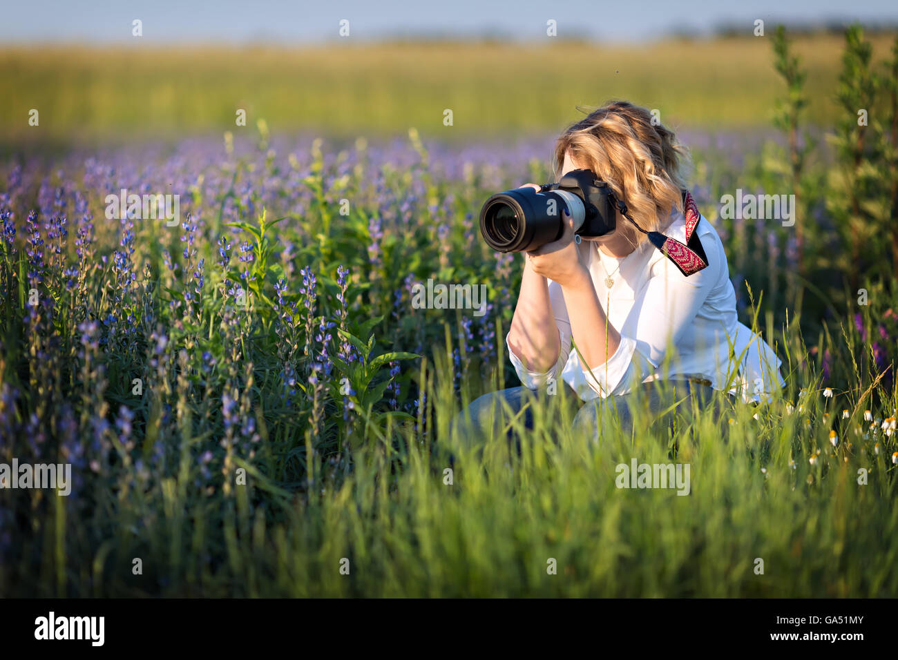 female photographer taking photos of nature - Stock Image