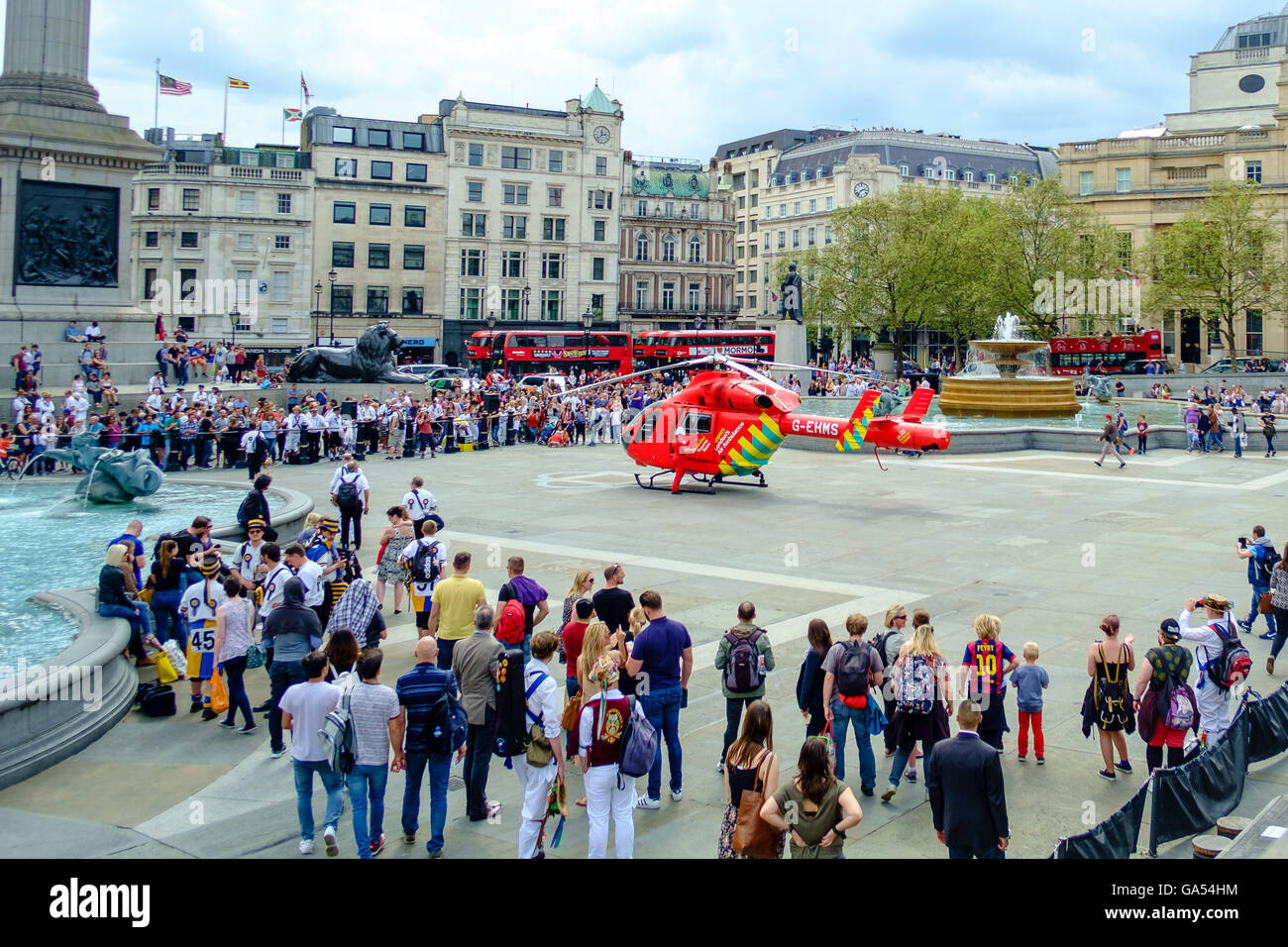 An emergency HEMS helicopter landing in Trafalgar Square, London - Stock Image