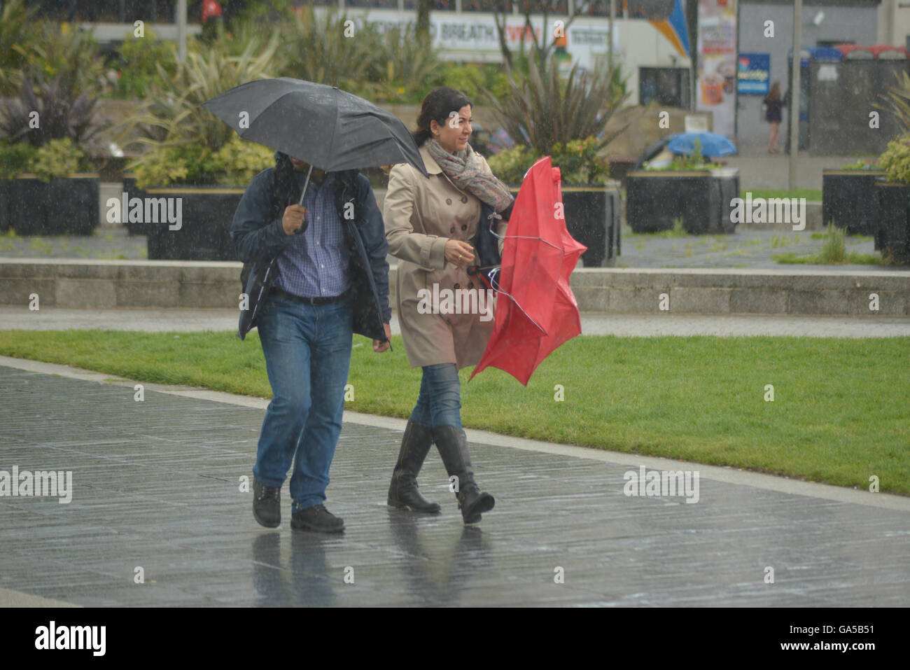 Manchester, UK. 02nd July, 2016. People, believed to be from Manchester, experiencing rainy weather on July 2nd, Stock Photo
