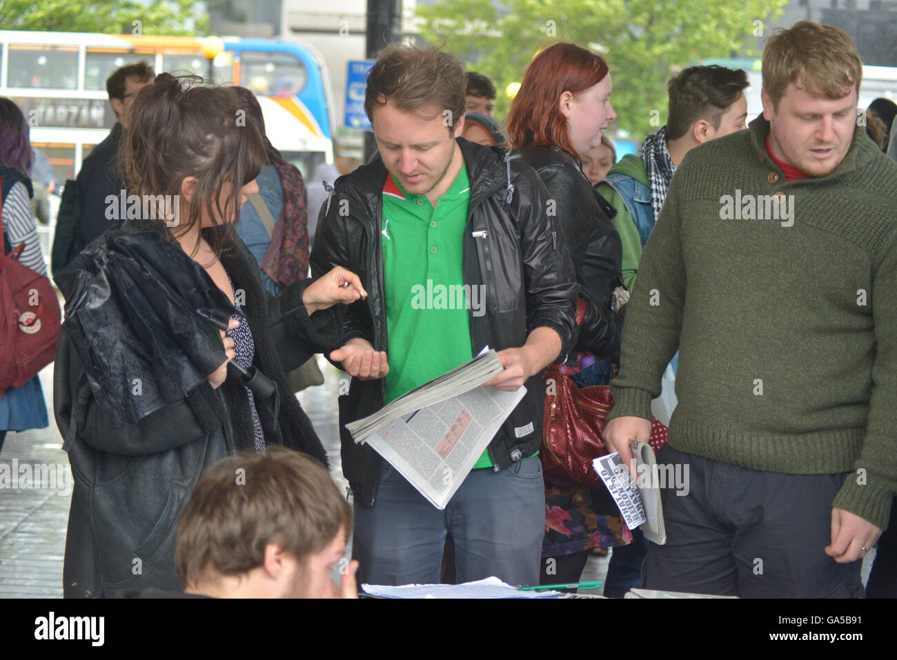 Manchester, UK. 02nd July, 2016. A person buying a copy the the Fight Racsim-Fight Imperialism (FRFI) party newspaper, - Stock Image