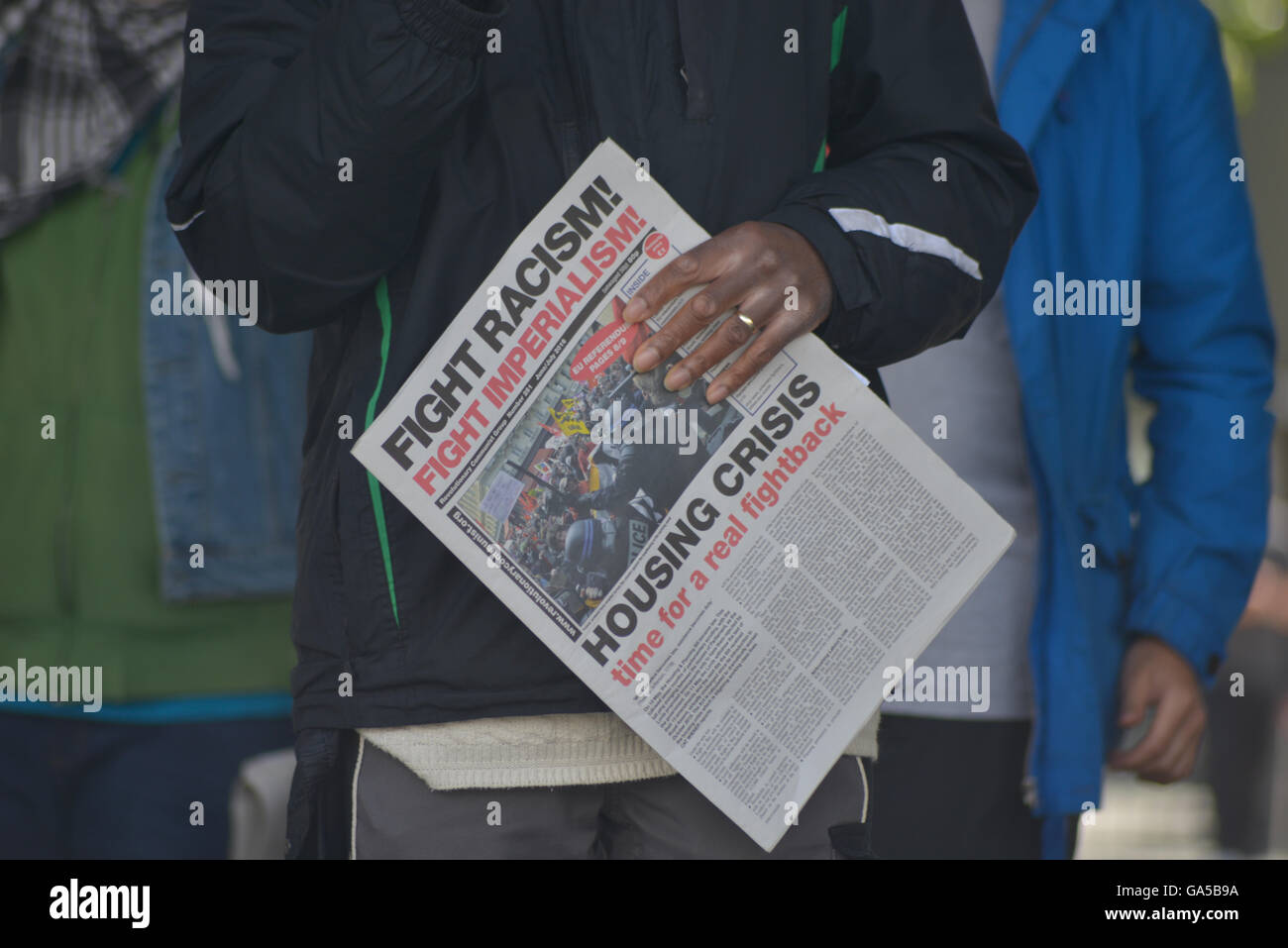 Manchester, UK. 02nd July, 2016. A person holding on to a copy of the Fight Racism-Fight Imperialism party newspaper - Stock Image