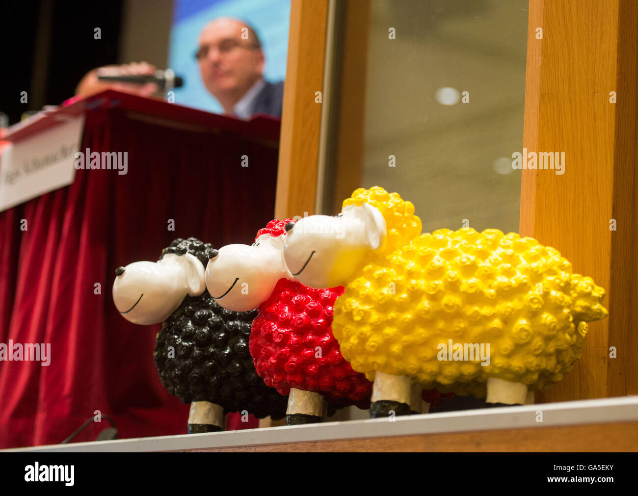 Werl, Germany. 3rd July, 2016. Three toy sheep coloured in black, red and yellow, resembling the German national - Stock Image
