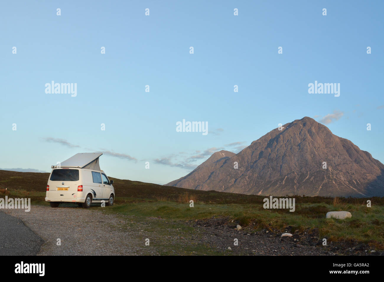 wild camping - campervan at daybreak in the Scottish Highlands parked close by Buachaille Etive Mor, Glen Coe, Scotland, - Stock Image