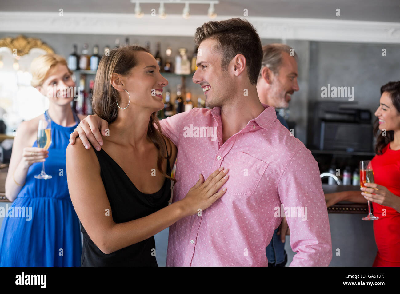 Couple embracing each other in restaurant - Stock Image