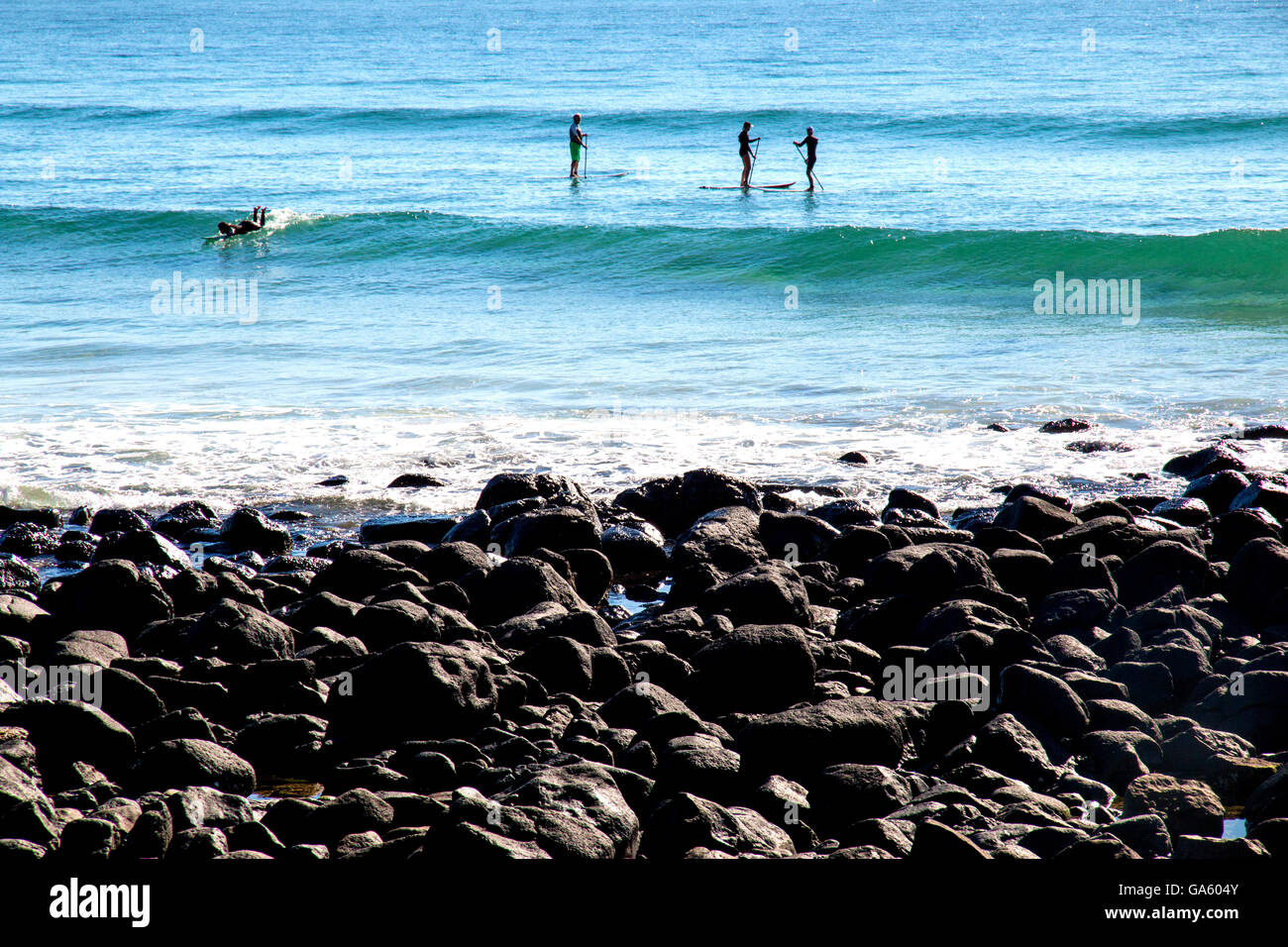 Board riders of various kinds off Burleigh Heads in Australia - Stock Image