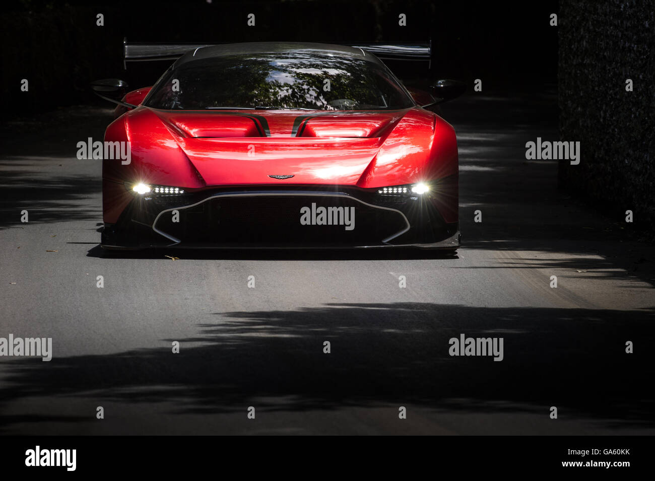 An Aston Martin Vulcan drives past the flint wall during the Super Car Run at the Goodwood Festival of Speed 2016 - Stock Image