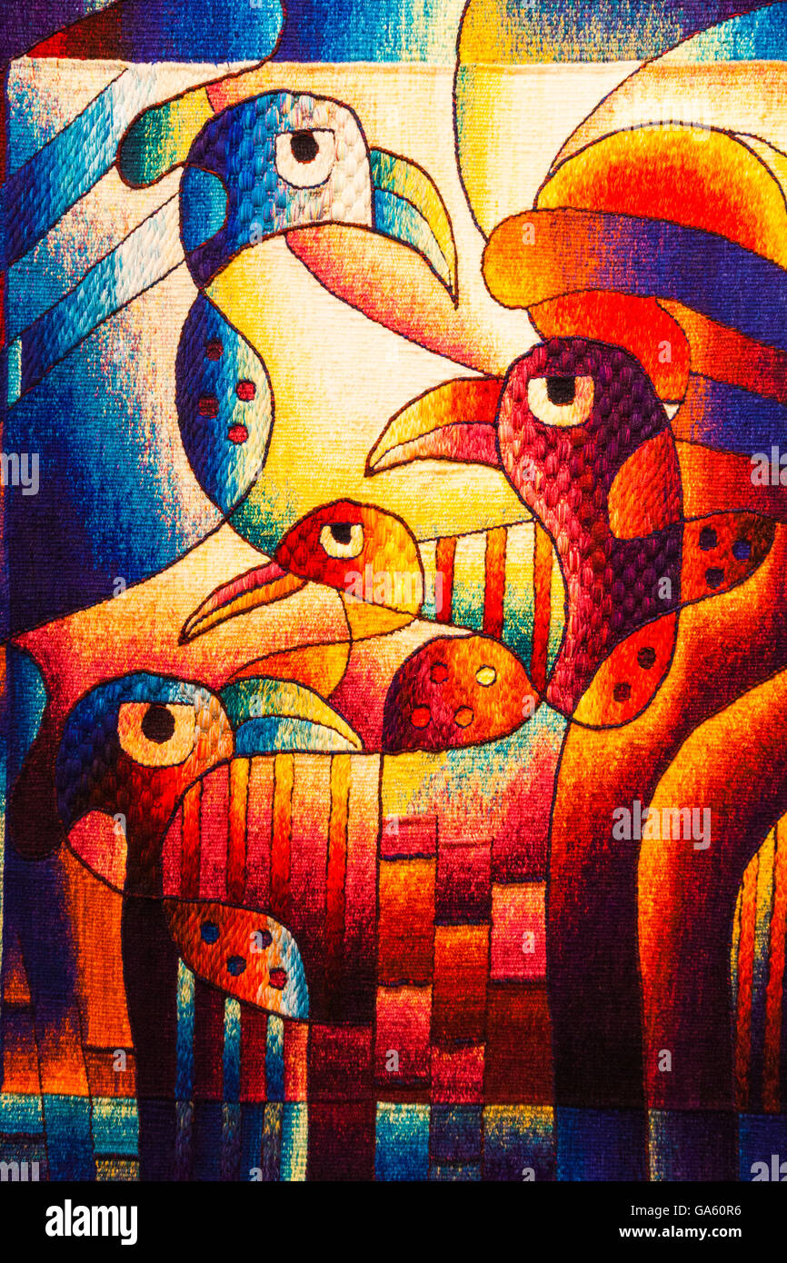 Handwoven panel on display in Cusco depicting Peruvian art forms in their rich history - Stock Image