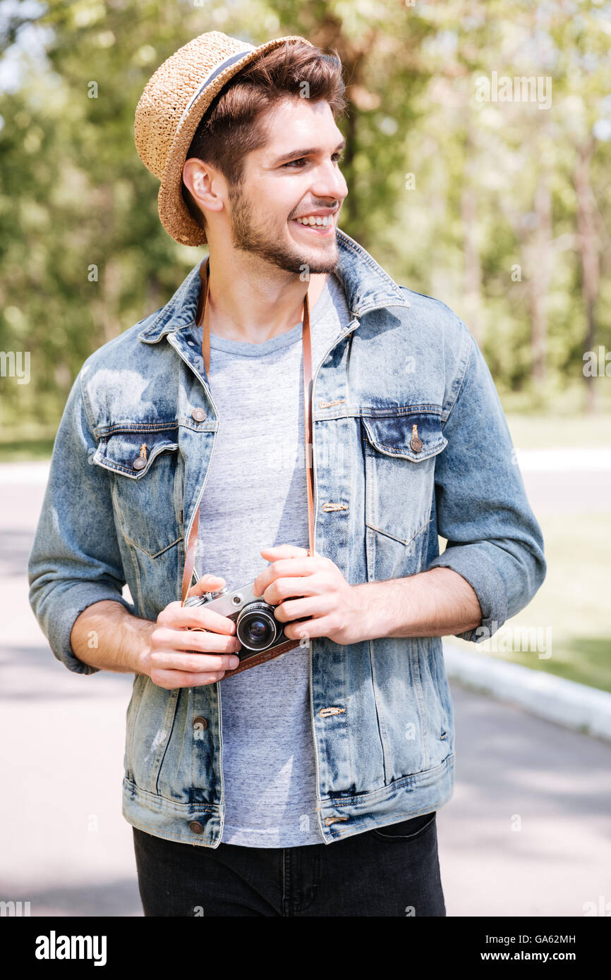 Portrait Of A Handsome Hipster Guy Holding Camera Wearing Hat Stock Photo Alamy