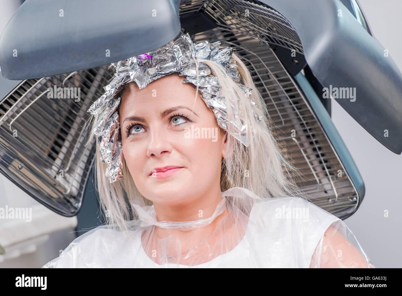Beauty Salon Caucasian Woman Under Hair Dryer Awaiting