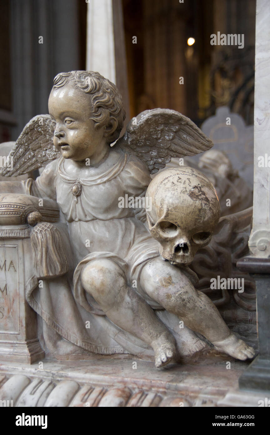 winged marble sculpted cherub holding a skull in a church in Sweden Stock Photo