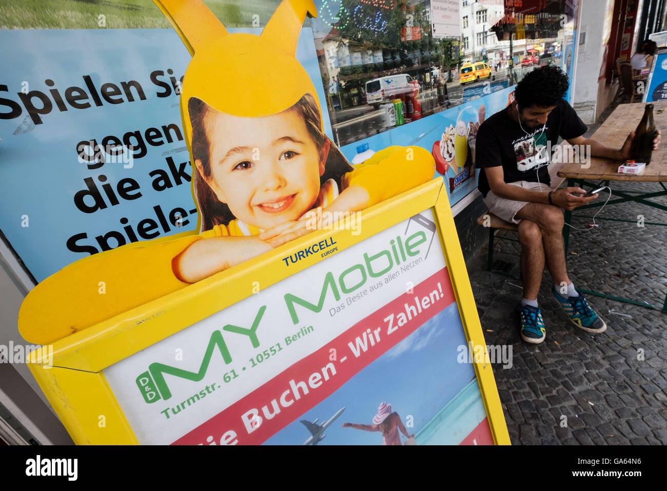 Advertisement for Turkcell Turkish mobile phone company outside shopping Neukolln Berlin Germany - Stock Image