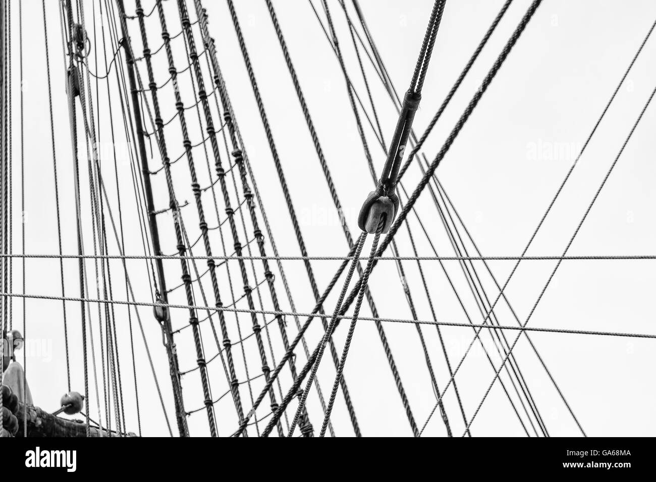 The mast with rigging of a sailing ship - Stock Image