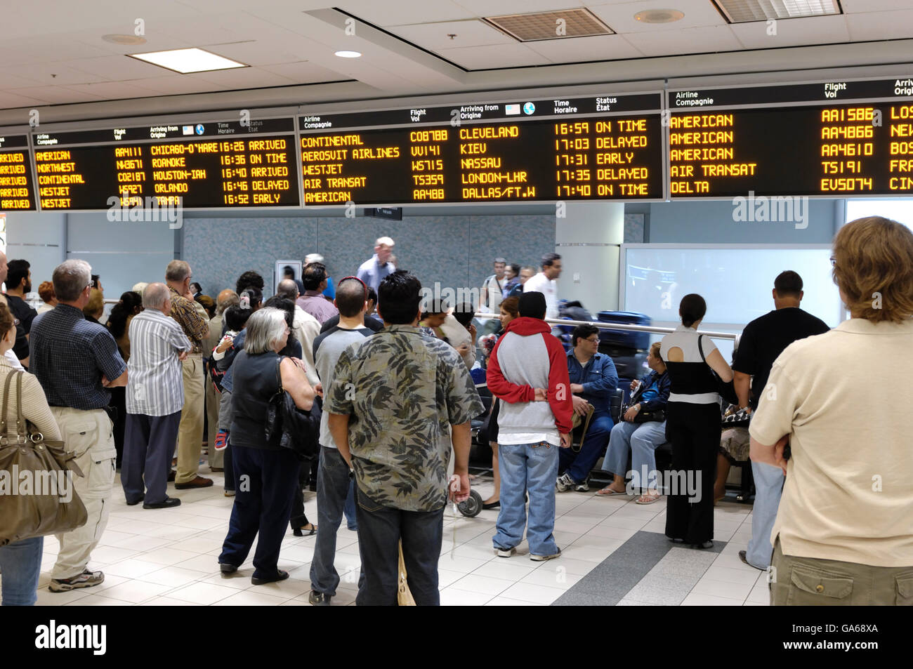 People waiting at arrivals hall of Toronto Pearson International Airport, Toronto, Ontario, Canada, North America - Stock Image
