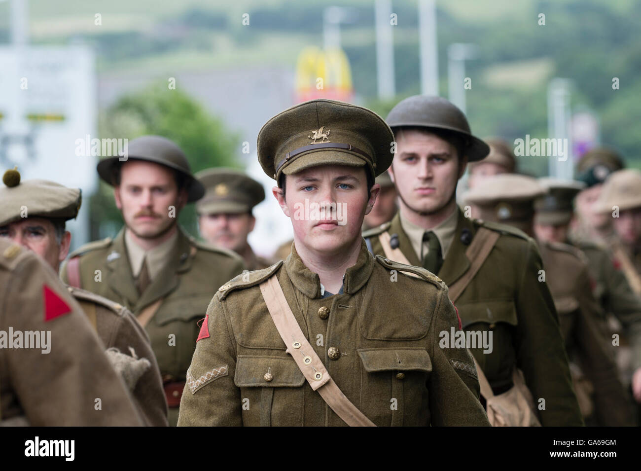 Young men dressed in First World War uniforms in Aberystwyth Wales as part of a UK-wide project to commemorate the Stock Photo