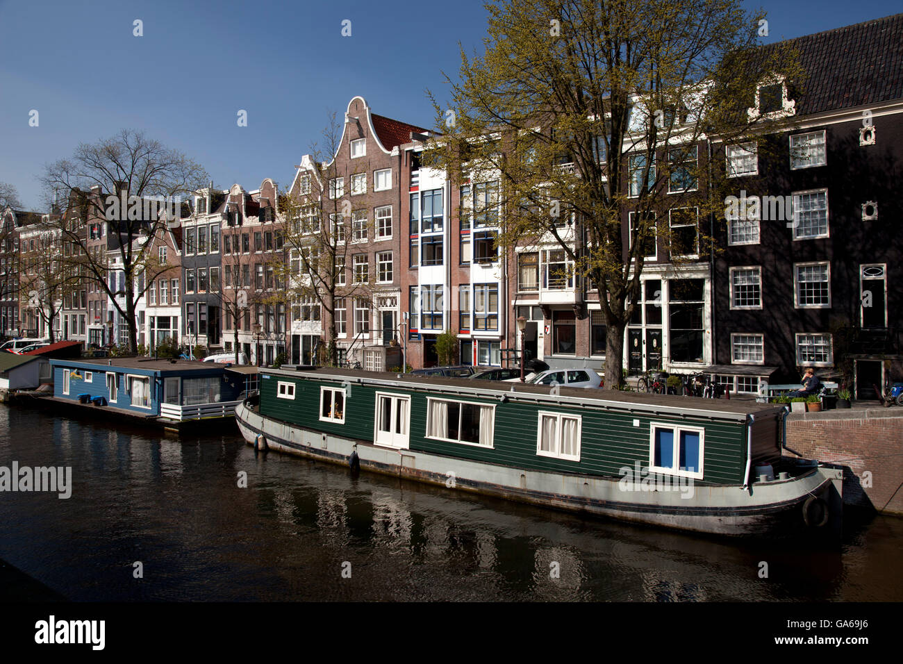 Houseboats on the Prinsengracht canal, Amsterdam, The Netherlands, Europe - Stock Image