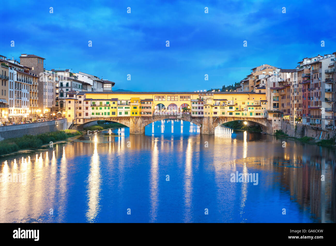 River Arno and Ponte Vecchio at night in Florence, Italy. - Stock Image